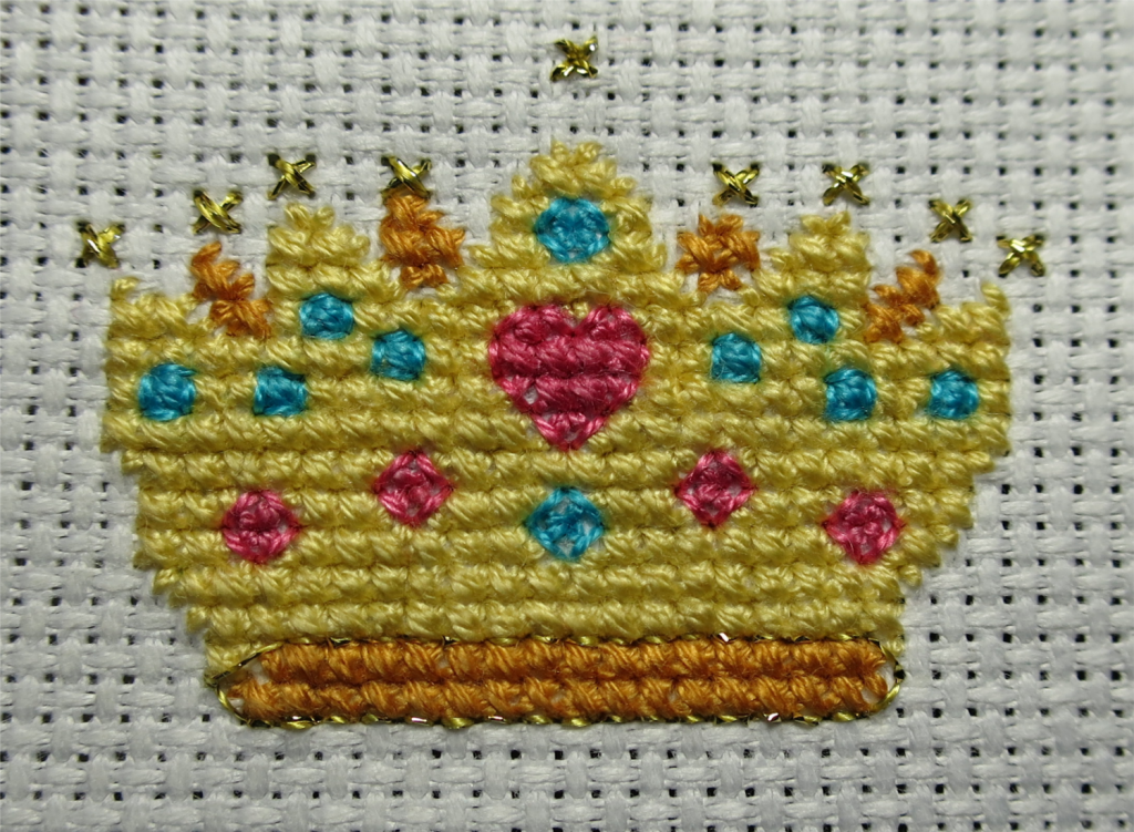 Metallic stitching done and started on the backstitch.
